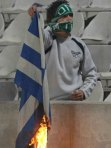 greek-flag-burn-omonoia